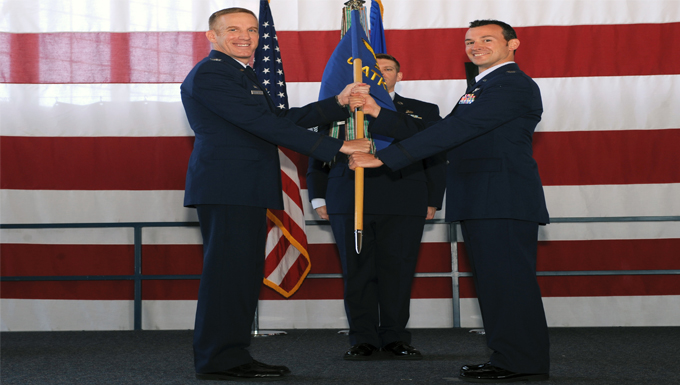 Col. Case Cunningham, 432nd Wing commander, left, hands the guidon for the 89th Attack Squadron to Lt. Col. Albert, 89th ATKS commander, during a redesignation ceremony at Ellsworth Air Force Base, S.D., June 21, 2016. With the 28th Bomb Wing being realigned under Air Force Global Strike Command from Air Combat Command in October 2015, the 432nd ATKS became a tenant unit at Ellsworth AFB and needed to be renamed. (U.S. Air Force photo by Airman 1st Class Denise M. Nevins/Released)
