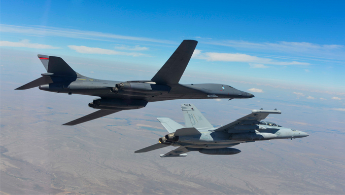 A B-1 bomber and EA-18G Growler bank to the left during a training sortie near Ellsworth Air Force Base, S.D., July 15, 2016. The training focused on further improving joint mission tactics between Air Force and Naval forces. (Courtesy Photo)