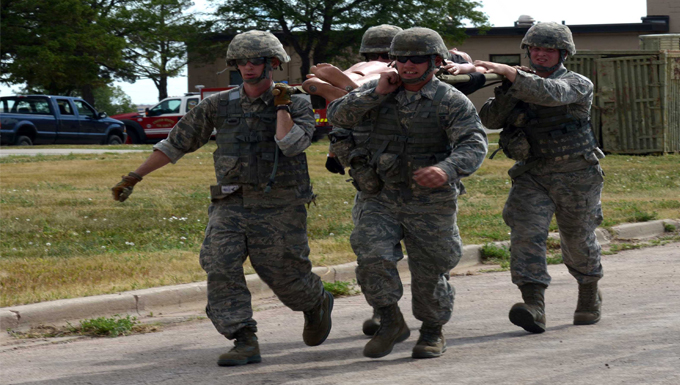 Airmen with the 28th Civil Engineer Squadron litter carry a training dummy during the Prime Base Engineer Emergency Force (BEEF) challenge at Ellsworth Air Force Base, S.D., July 22, 2016. The purpose of the Prime BEEF challenge is a way to put field experience to the test in a competitive environment. (U.S. Air Force photo by Airman Donald Knechtel)