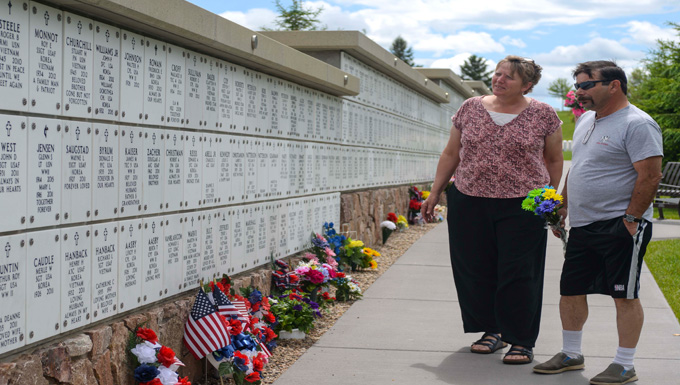 Yvone, left, and Galen Tapio, locals of Rapid City, S.D., search for their relative's grave at the Black Hills National Cemetery in Sturgis, S.D., May 28, 2016. Family members visit the cemetery throughout the year to mourn for their service members who have passed. To contact the cemetery, call (800) 535-1117. (U.S. Air Force photo by Airman 1st Class Sadie Colbert/Released)